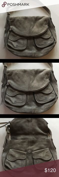 """EUC Lucky Brand Gray Metallic Suede Purse Only used once or twice Lucky Brand Metallic Suede Hobo style Purse with magnetic closure. Inside is lined in a navy fabric has a pocket from the front fold over that's 17"""" deep but does fold over to close the purse. Other measures moments are about 14x10x3 inches. Please ask if you have any questions!   Smoke Free Home Lucky Brand Bags Hobos"""