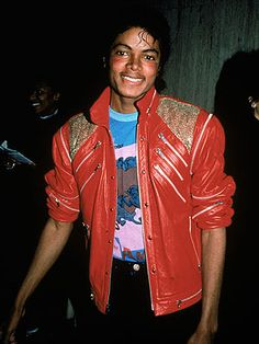 """Michael Jackson 1982 for his teen gang video """"Beat It,"""" the singer picked a casually cool outfit that would inspire millions to wear zipper-accented red leather jackets in a decade-defining look for the '80s."""