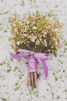 The bridesmaids will carry bouquets of pale pink wax flower wrapped in light gold ribbon with the stems showing