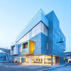 """South Korea's Studio Koossino created a concrete building with white and yellow protrusions to provide shared workspaces for an artists' community north of Seoul.  Designed as a """"coffee culture space"""", the Maxcube facility sits in the cultural village of Heyri, which was set up by a group of writers, painters, actors, architects and musicians. Read the full story on dezeen.com/tag/Seoul #architecture #Seoul"""