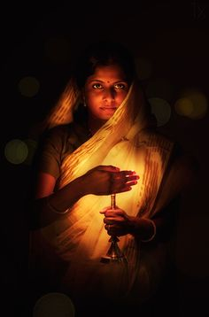 A lamp or a dia is lighted in all Hindu homes in the evening to welcome Goddess Laxmi (Goddess of Wealth and Wellbeing). Turmeric and Vermilion powder (haldi and kumkum) is applied on the foreheads of married women in the house, as its believed that Goddess Laxmi can take any form and so as to welcome her to the household...