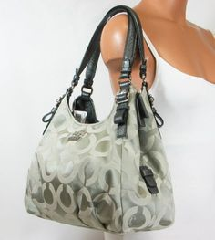 I totally want this handbag in pink or baby blue!!  Coach Madison Op Art Sateen Maggie Shoulder Bag « Holiday Adds