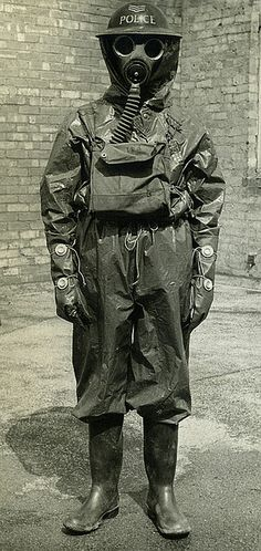 A sergeant of Manchester City Police poses in full gas protection suit during the early years of World War 2.