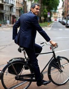 Designer suit and on a bike?  In Paris...OUI!!