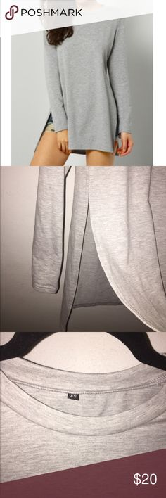 """Grey Split Long Sleeve Tee Boutique Brand. Store photo is better representation of the color (a light grey) Aprox 28"""" long from shoulder and about 15"""" pit to pit. Tops Tees - Long Sleeve"""