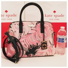 """SALE New Kate Spade pink black feathers Rachelle 100% authentic Kate Spade small Rachelle Crossbody Satchel in multicolor regal plume print. Grainy vinyl with black leather trim. 14-karat light gold plated hardware. Zip top closure and fabric lining. Inside zip and slip pockets. Handles drop 4"""". Longer detachable and adjustable strap. Measures 12.5"""" (L) x 9"""" (H) x 4.5"""" (W). Brand new with tags. Comes from a pet and smoke free home. This item does not come with dustbag. Kate Spade shopping…"""