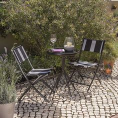 Offering seating for up to two people, this Helsinki bistro set has been designed with a black and white stripe design suitable to compliment all types of outdo. Garden Sofa, Outdoor Garden Furniture, Outdoor Tables, Outdoor Spaces, Outdoor Decor, Black White Stripes, Black And White, Lush Lawn, Foldable Chairs