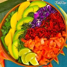 My Last Supper in Costa Rica! A bed of local greens topped with mango, avocado, purple cabbage, carrot and beet slaw, tomatoes, and freshly-squeezed lime! Life in FullyRaw Technicolor!