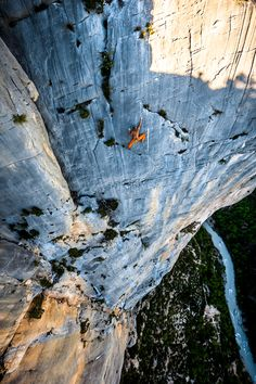 "Mich Kemeter freesolos the 6a+ last pitch of ""Marches du Temps"", 300m off the deck in the Verdon Gorges / Photo: Alex Buisse"
