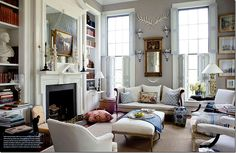 Love the arrangement of the furniture in this room...tied together with the same color but so spaced out. Cool.