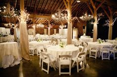 Grgeous indoor barn style wedding I like how the posts are covered in fabric