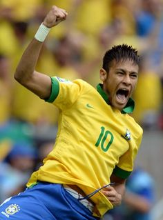 Brazil's forward Neymar celebrates after scoring against Japan during FIFA Confederations Cup Brazil 2013 Group A match, at National Stadium in Brasilia June 15, 2013.