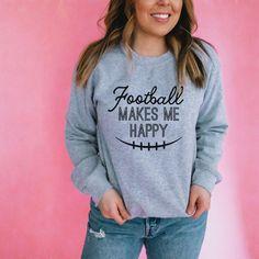 Football Makes me Happy Sweatshirt - The Stadium Chic. Hoodie, pullover, sweatshirt, happy, grey, women, feminine, football, American football, T-shirt, tee, graphic tee, football mom, gift, NFL, trendy, chic. Graphic Tees, Graphic Sweatshirt, Football Outfits, Crystal Rose, Rose Design, Make Me Happy, Christmas Sweaters, What To Wear, Pullover