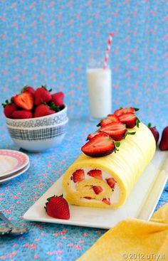STRAWBERRIES & CREAM SWISS ROLL / 3oz Self Raising Flour  3 Eggs (separated) Pinch of Salt 3oz  Sugar / Few drops Vanilla   FILLING / Carton Cream (whipped)  8-10 Strawberries (chopped) / Sugar / Put egg whites in bowl & add pinch of salt / Beat until stiff / Add sugar & beat / beat in egg yolks until thick / add vanilla / Spread in pan & Bake for 10 min /  Roll cake up from its longest edge with paper inside. Let cool / spread whipped cream & strawberries / roll up / dust with sugar / EAT!!! YUM!
