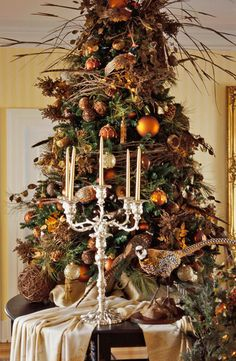 """""""Nature"""" tree as backdrop for elegant candelabra - 42 Simple Holiday Decorating Tips - Traditional Home®"""