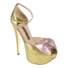 An ultra feminine open toe closed back sandal in striking metallic green pearl leather adorned with an oversized pale pink metallic bow on a towering 140mm stiletto heel.