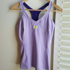 "Under Armour Work Out Tank Pastel purple color racer back tank. Built in shelf bra without padding. Size tag has been removed- but this is a small.  Bust 14"" Length 23"" Excellent pre-loved condition. Under Armour Tops Tank Tops"