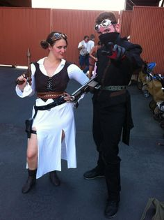 Steampunk Leia and bounty hunter at Star Wars Weekends 2012.