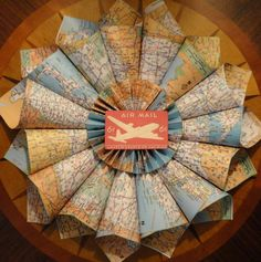 I love maps and I love wreaths... what more could I ask for? This would also be cute using a kids book for a child's room!!
