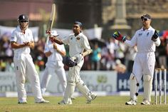 Sri Lanka captain Mahela Jayawardene raises his bat after scoring a century on day one of the first Test against England at Galle.