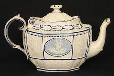 SUPERB ANTIQUE CASTLEFORD LEEDS TYPE FELDSPATHIC STONEWARE POTTERY TEAPOT (10/21/2012) more unusual light blue cameos to each side. Measures 5.75 inches tall and 10 inches end to end. Needs some work, the handle has been off and repaired, there is some loss to the end of the spout, small chip to the rim and hinge and a little section of the hinge to the body has been off and reglued