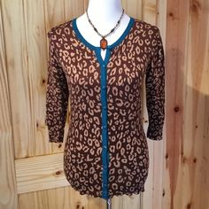 Lightweight animal print sweater Animal print sweater that is lightweight. It is a Merona size medium. It's brown, light brown, with dark  turquoise trim. It is only been worn one time. The bottom is ribbed as well as the cuff area on the sleeves. Armpit to armpit measures 17 1/4 inches. The sleeves are 16 1/2 inches long The center back to the bottom is 24 1/2 inches. It's a nice lightweight sweater for spring!! Merona Sweaters