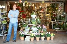 Ingimage | Stock Image Details: 02G69384 - Man working in florist Royalty Free Images, Table Settings, Stock Photos, Table Decorations, Detail, Commercial, Home Decor, Decoration Home, Room Decor