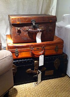 vintage trunks at the foot of a bed..looking for this for top of cabinet at work