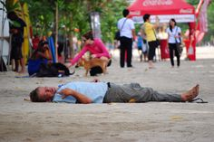 A drunk man sleeping on Kuta Beach by Syefri Luwis - Photo 136768205 - 500px