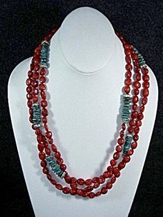 Denver Designer polished red coral three strands Necklace 23 inches accented with Turquoise and Rhinestone spacers.