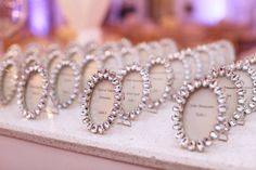Escort card frames // photo by Melody Melikian Photography
