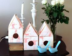 Paper Bird Houses.  These would be so pretty in white or light blue with lights inside for Christmas.