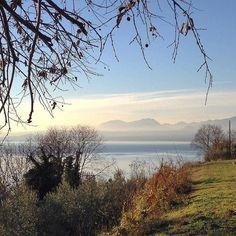 #Repost @miramar99  sguardo verso la sponda bresciana ... quiete__ #lagodigarda #bardolino #natale #PhotoGC #instagarda #naturelovers #lakegarda #gardasee #view