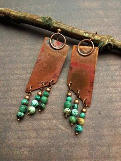 Handmade copper earrings with African turquoise. I hand crafted these earrings…