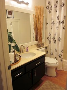 this would be awesome for updating our bathrooms a bit! we have a countertop/ledge over toilet/big mirror exactly like that in powder room that this would be perfect for. this blog is great, be sure to read in more detail sometime.