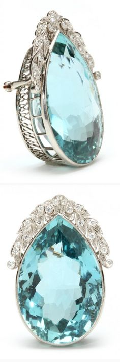 Edwardian Platinum, Aquamarine, and Diamond Brooch  the pear cut aquamarine gemstone  weighing approximately 85.66 carats bezel set and with a foliate cap surmount accented with (19) full cut bead and bezel set diamonds weighing approx .57 total cara completed with a vintage yellow gold single pin stem and locking C clasp.