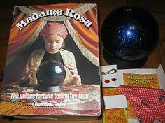"""I still find it odd that I was allowed to have this as a present. I think I wanted it after seeing ads for it. You dressed up to look like a stereotypical gypsy and a ring activated a light so that you could """"read"""" an image on a card through a red spot in the crystal ball. Not quite the psychic experience I was expecting!"""