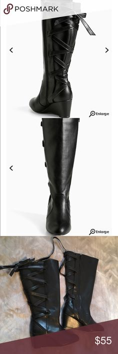 Torrid black lace back wedge boot size 10W Torrid black lace back wedge boot. Size 10W. Barely seen flaw on last pic. These do not come with the box but have not been worn torrid Shoes Lace Up Boots