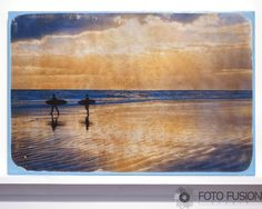 """12x18 Surfer Silhouette - Fine Art on Wood:Photo Transfer Art on Wood, Sunrise Surfers at Daytona Beach Active. This is an 12"""" x 18"""" Ready-to-Hang fine art mixed media photo transfer artwork. All of my images are hand-transferred onto a birch wood panel, and many of my works include under painting, additional textures and/or painted or stained edges. Each image is unique and may contain varied textures and qualities. The photograph is transferred directly onto a 12"""" x 18"""" 7/8"""" deep…"""