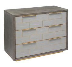 Evoking Hollywood glamour, the wood Fabienne Occasional Chest boasts a light grey wash oak finish paired with light grey shagreen and antique brass accents. Dimensions: x x shagreen/ wood/ brassFinish: light grey/ grey wash oak/ antique brass