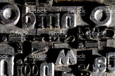 A background from many historic typographical letters in black and. Wall Ideas, Bathroom Wall, Letterpress, Royalty Free Stock Photos, Age, Metal, Mural Ideas, Letterpress Printing, Letterpresses