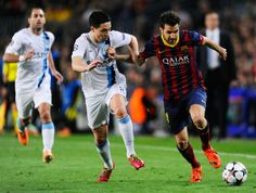 Cesc Fabregas of Barcelona holds off Samir Nasri of Manchester City during the UEFA Champions League Round of 16, second leg match between FC Barcelona and Manchester City at Camp Nou on March 12, 2014 in Barcelona, Catalonia.