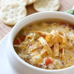 A quick, no-fuss version of chicken tortilla soup. Topped with shredded cheese and served with tortilla chips. Yum!