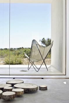 Completed in 2011 in Formentera, Spain. Images by Estudi EPDSE. Place Es Pujol de s'Era is a fairly representative fragment of the inland landscape of the island of Formentera. Exterior Design, Interior And Exterior, Interior Minimalista, Minimal Home, Inspiration Design, Butterfly Chair, Minimalist Interior, Home Living, Concrete Floors