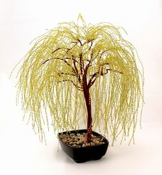 Do you love bonsai trees, but cant seem to keep them alive? Then a beaded bonsai tree would be just perfect for you.  The Golden Weeping Willow Bonsai Trees grace comes from its long sweeping, low branches that droop to create a beautiful cascading canopy. This piece is made entirely of wire, glass seed beads in a mixture of yellow, green, and clear, and a little floral tape. The long beaded branches are twisted brass wire, and the trees main branches and trunk are tightly wrapped by hand…
