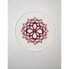 "Hand crocheted motif, in shades of pink, mounted on a 3½"" x 4½"" (8.9 x 11.4cm) white aperture greetings card, with pale pink foil border."