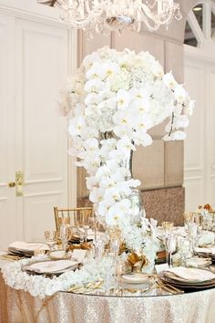 Glamorous cascading Orchid centrepiece with Carnations and Hydrangea. A very beautiful and stylish arrangement, that would particularly suit a glamorous and modern wedding or special event.