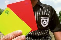 FIFA referee Carlos Henriques shows his FIFA yellow and red cards.