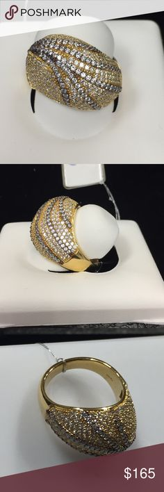 Gold Plated Sterling Silver w/  White CZ Ring Suzy Levian Gold Plated Sterling Silver Curved Dome with White Cubic Zirconia Pave Set Ring. This Ring has a closed under gallery filled with hearts for a comfortable fit with a Suzy Levian's SL logo. suzy Levian Jewelry Rings