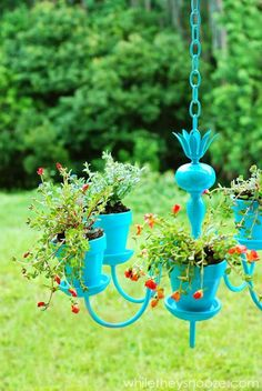 Upcycled chandelier planter, what a pretty addition to the garden this would make.